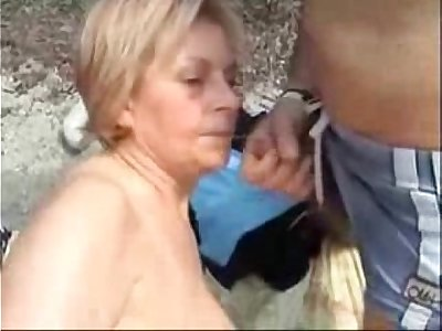 My mature bitch sucking cock of stranger at beach